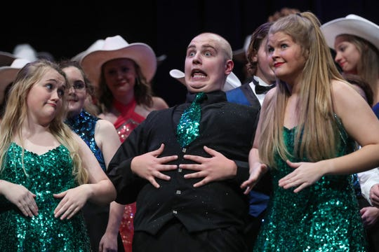 Center, senior student Austin Hewitt performs in Eastern High School's fall show choir concert in Greentown, Ind., Wednesday, Sept. 26, 2018. In October, Hewitt will undergo amputation of one leg below the knee, a result of his second battle with Ewing sarcoma bone cancer.