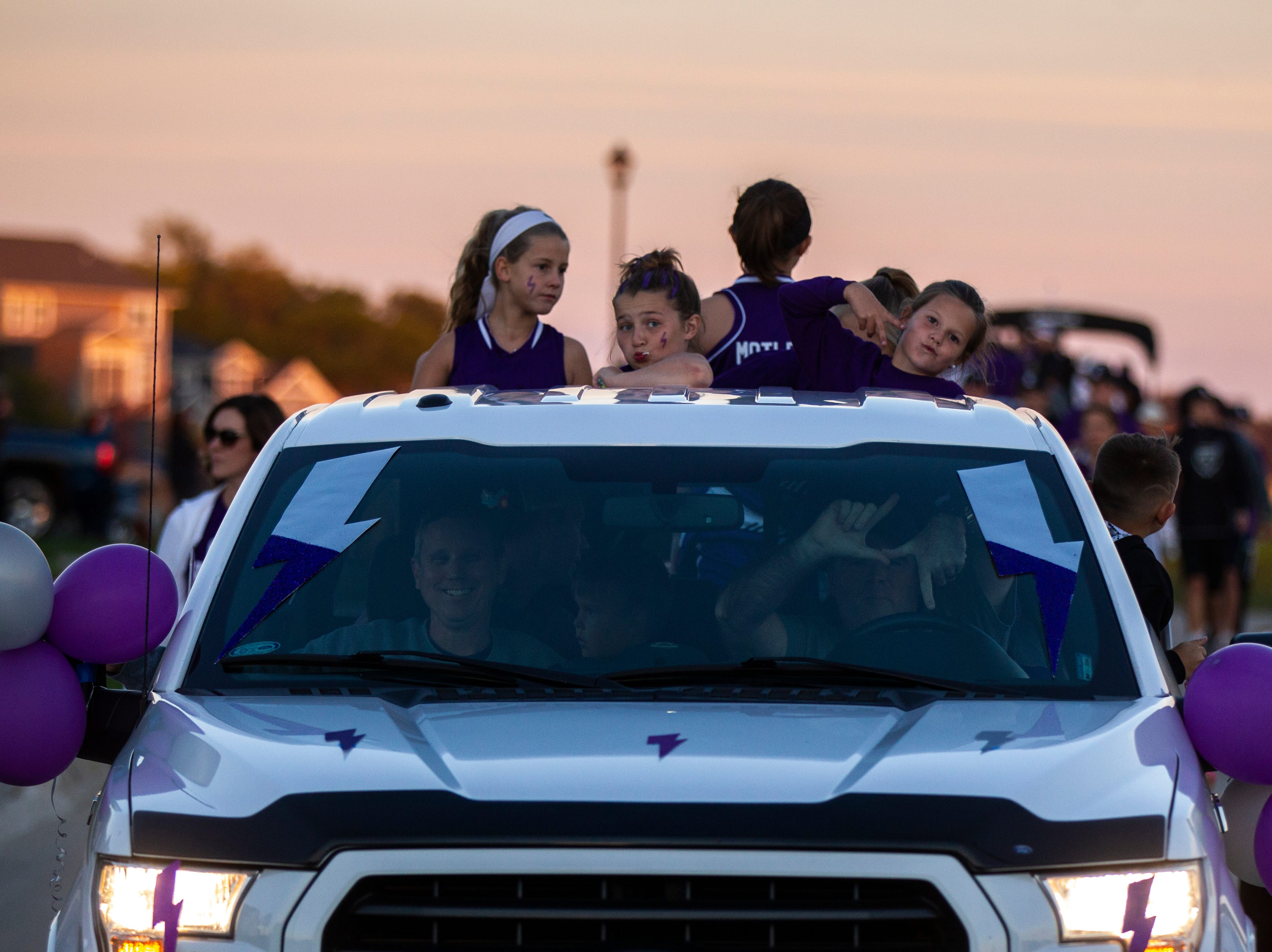 Parade participants pose during Liberty's homecoming parade on Wednesday, Sept. 26, 2018, in North Liberty, Iowa.