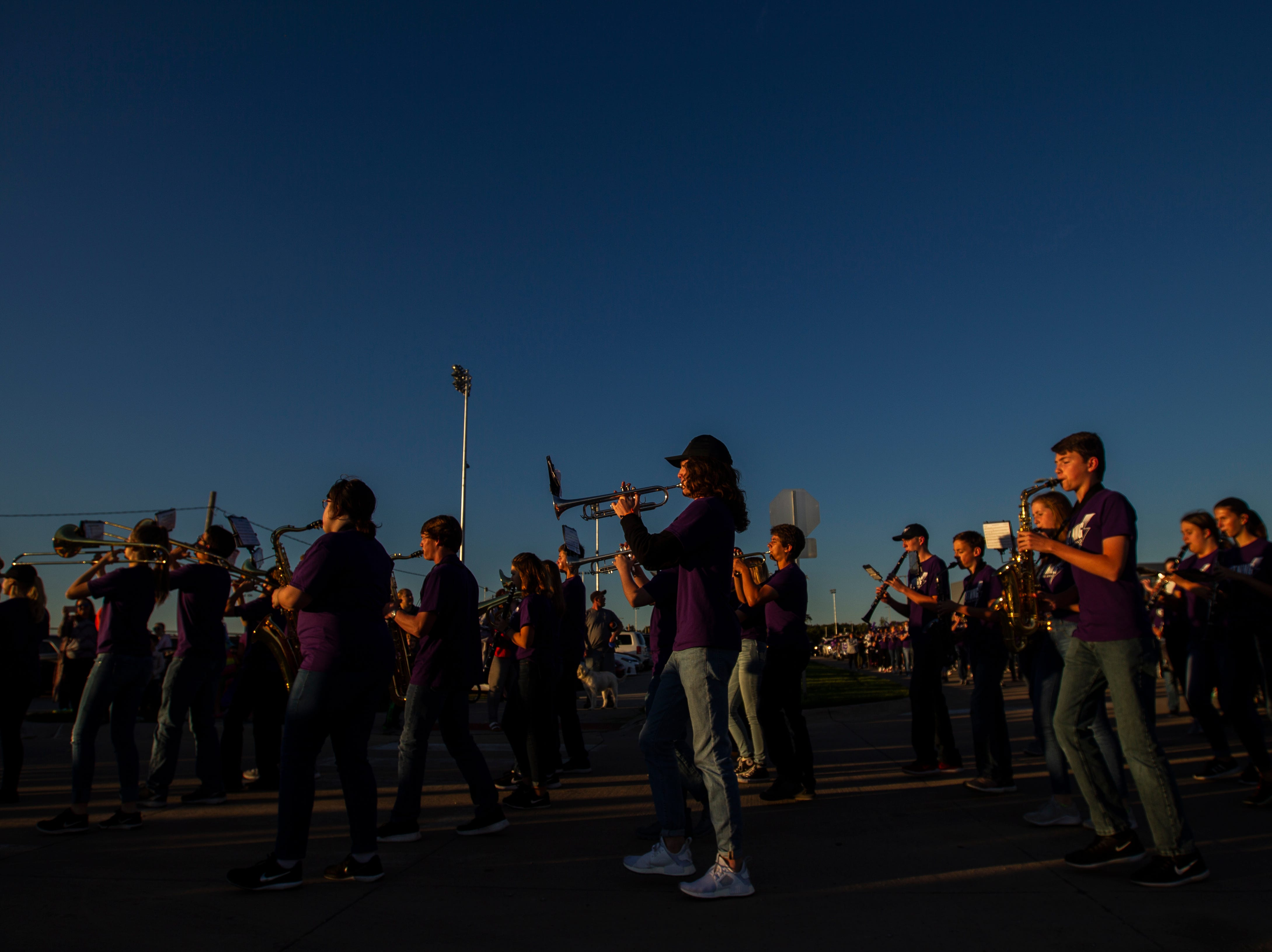 Members of the marching band perform during Liberty's homecoming parade on Wednesday, Sept. 26, 2018, in North Liberty, Iowa.