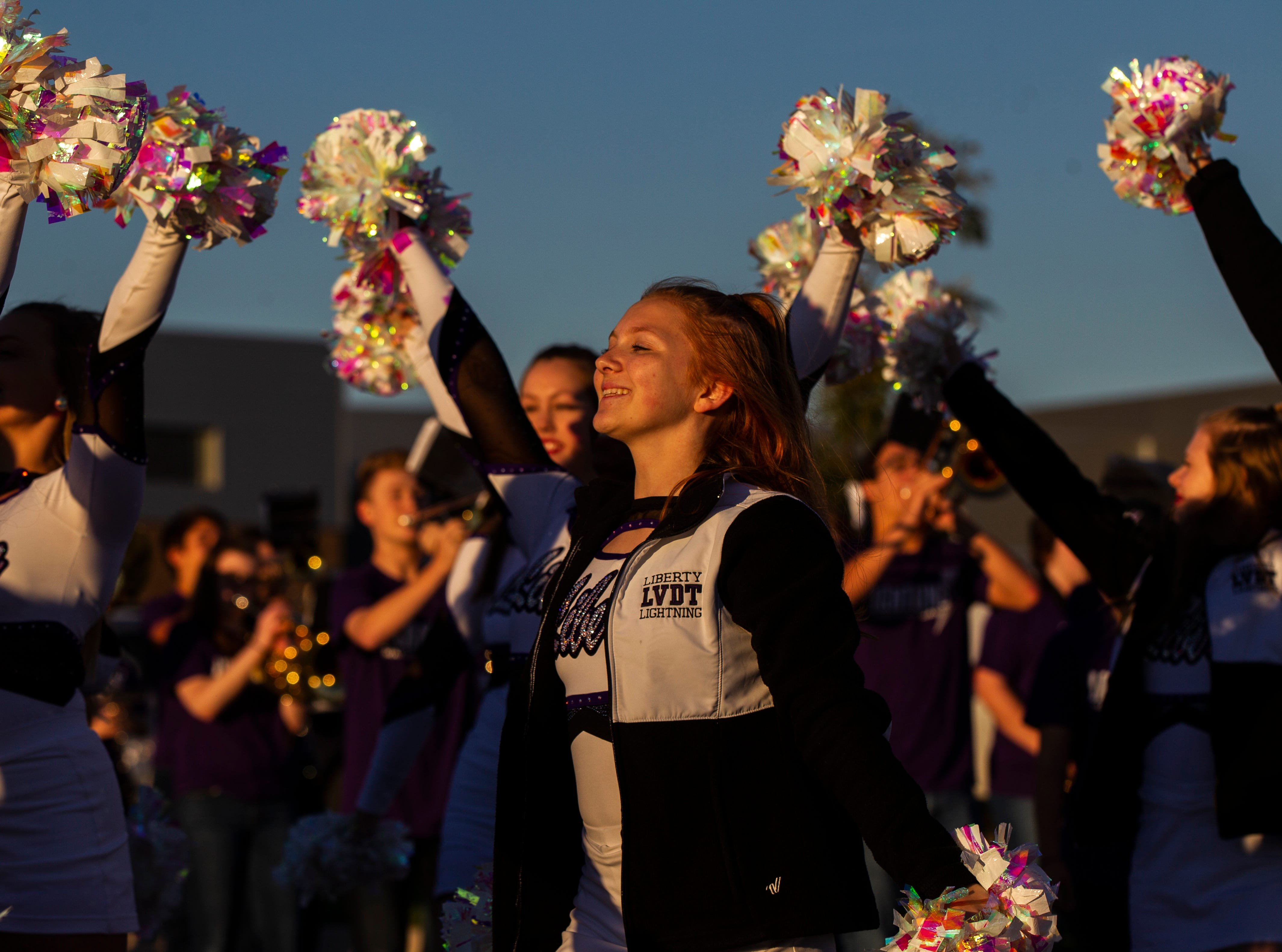 Cheerleaders perform during Liberty's homecoming parade on Wednesday, Sept. 26, 2018, in North Liberty, Iowa.