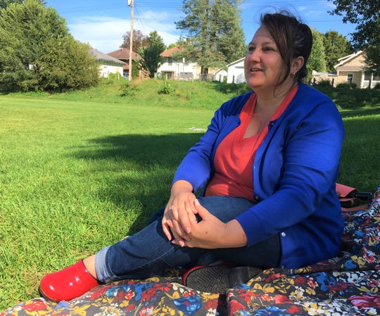 Ann Freerks, candid for Iowa City Council, explains how the field behind Longfellow Elementary came to be on Thursday, Sept. 27, 2018.
