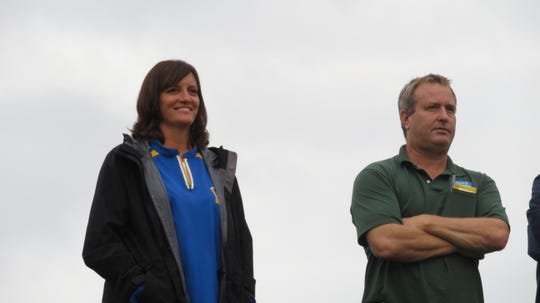 Marna and Andy Boerman watch their daughter Morgan and the Lansing High School varsity girls soccer team play during a cloudy day.