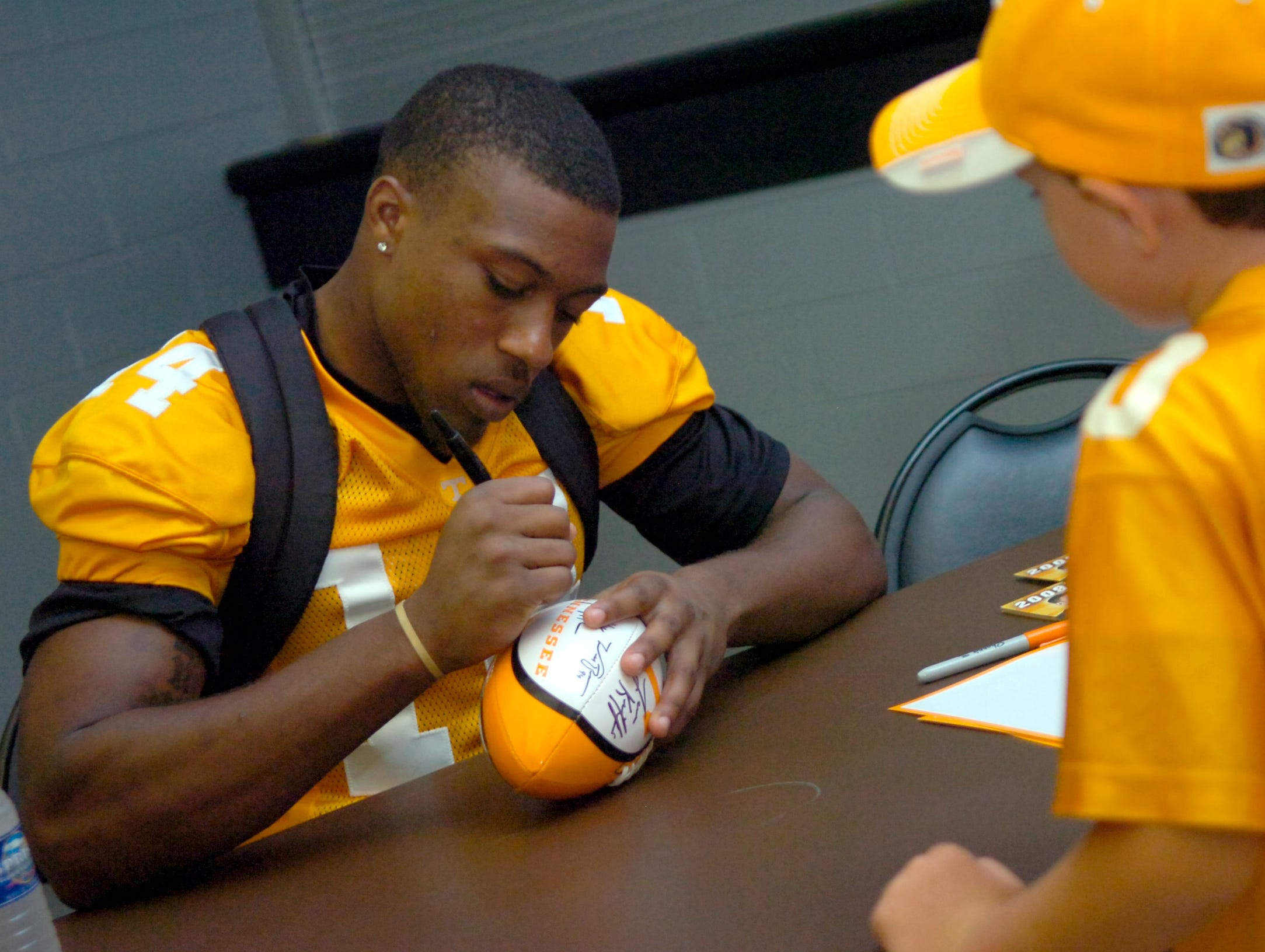 UT player Eric Berry signs autographs at the 2009 Welcome Back Barbeque held at Thompson Boling Arena on Friday night for head football coach Lane Kiffin and selected players.