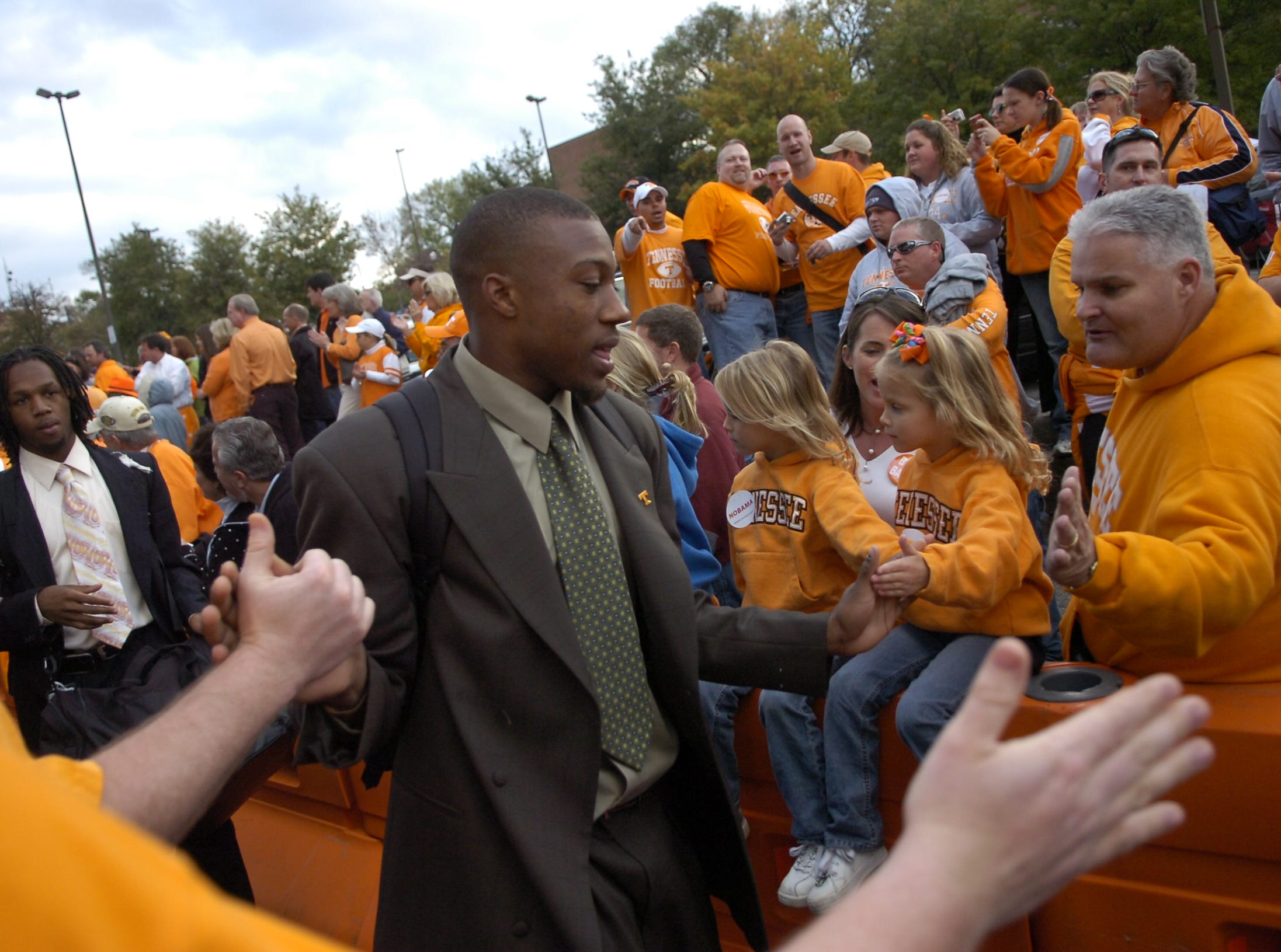 Tennessee defensive back Eric Berry (14) greets fans on his way into the game against Alabama on Saturday in Neyland Stadium.