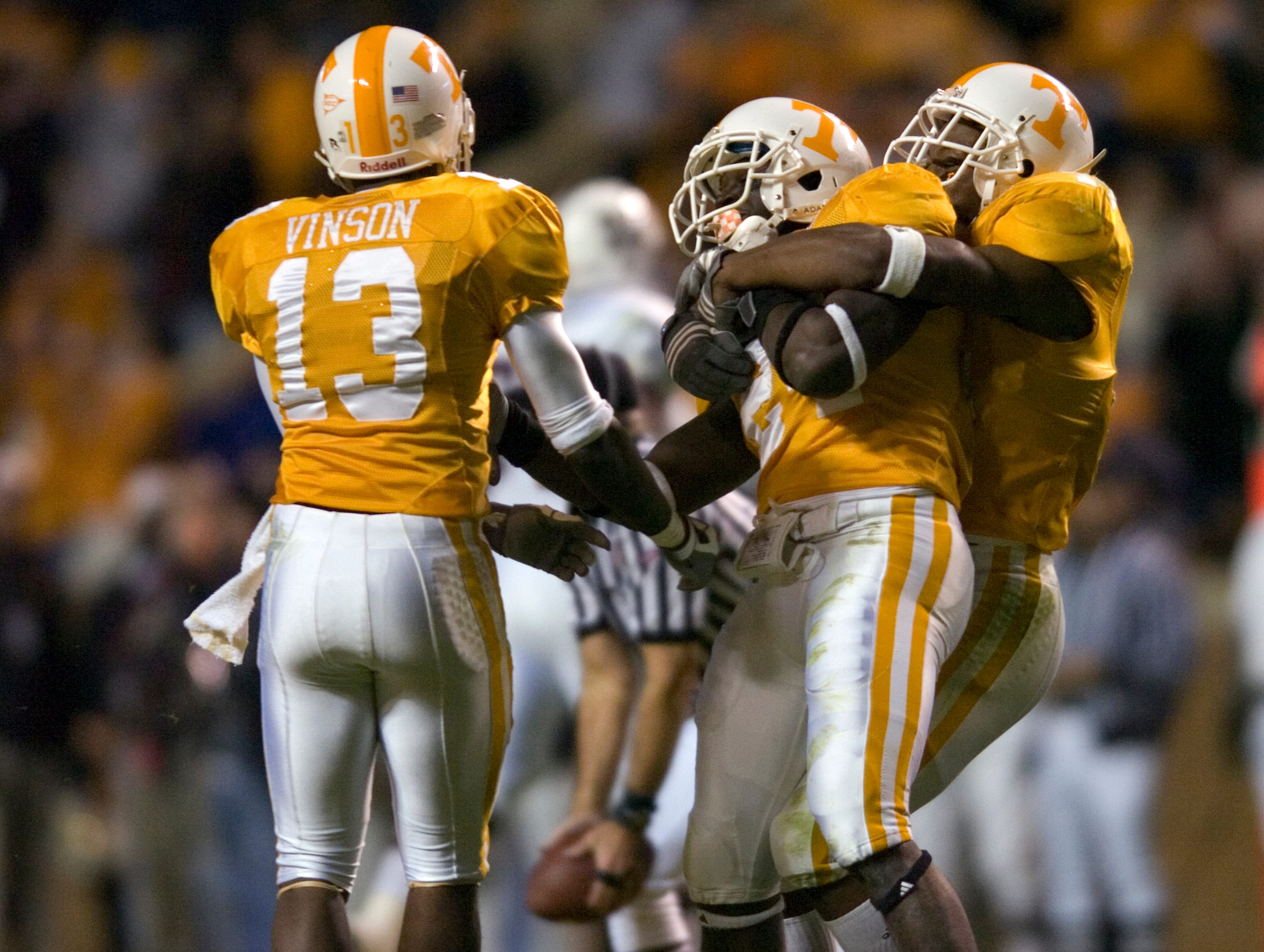 SAUL YOUNG/KNOXVILLE NEWS SENTINEL - Saturday, October 18, 2008 Tennessee defensive back Brent Vinson (13), left, and safety Eric Berry (14), right, celebrate with DeAngelo Willingham after Willingham  intercepted a Mississippi State pass on Saturday at Neyland Stadium. The interception was one of three by the Tennessee secondary as the Vols rolled to 34-3 win over the Bulldogs. The Vols improved their record to 3-4, 1-3 SEC.