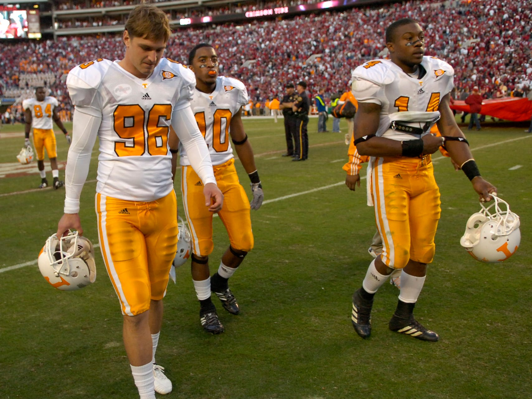 Tennessee players Chad Cunningham, Marsalis Teague and Eric Berry leave the field after the 12-10 loss to Alabama at Bryant Denny Stadium in Tuscaloosa on Saturday, Oct. 24, 2009.