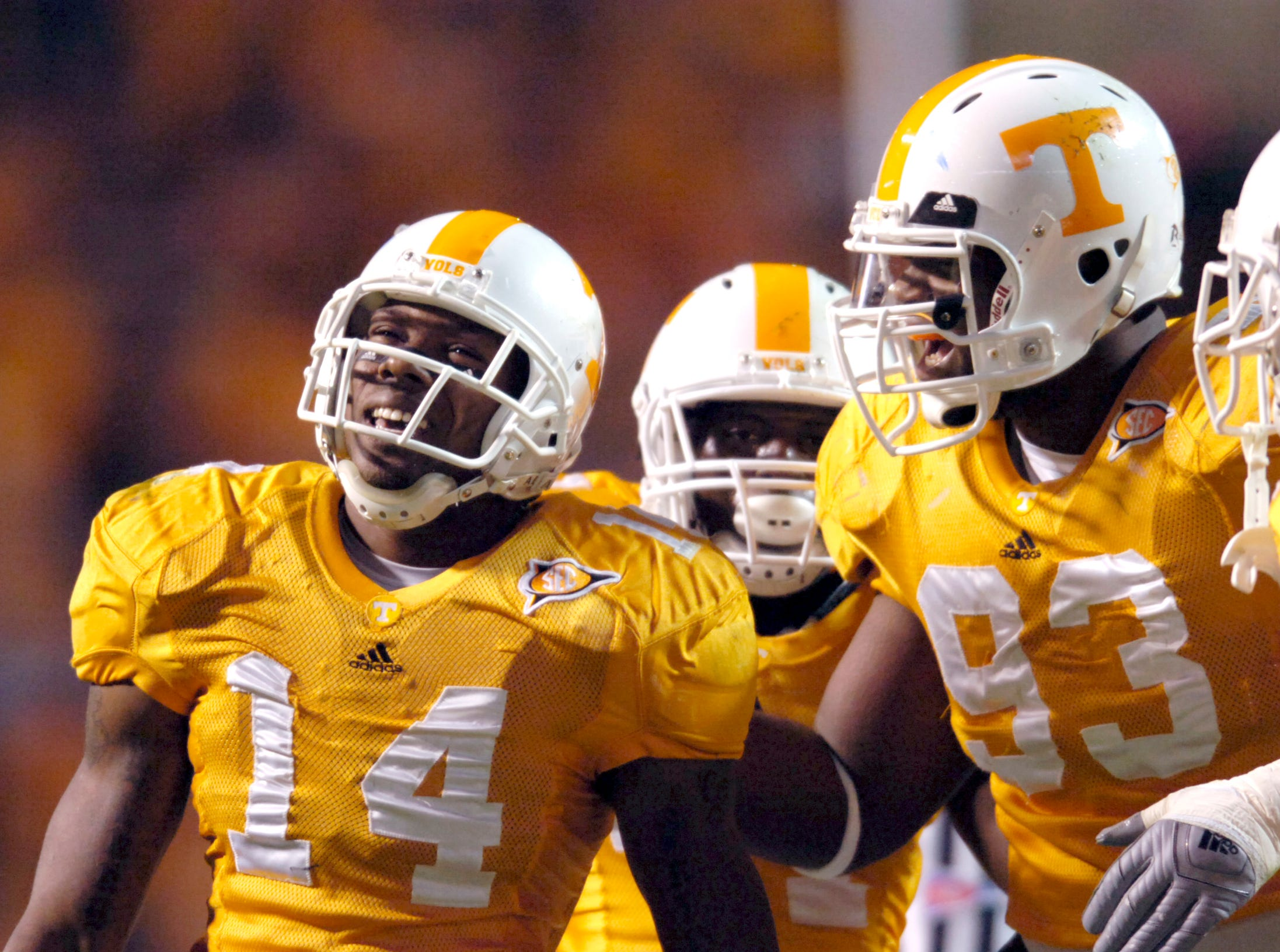 Tennessee cornerback Eric Berry (14) is congratulated by teammate defensive tackle Montori Hughes (93) after Berry intercepted a pass from Memphis  quarterback Will Hudgens (7). Berry is one interception and 8 yards away from breaking an NCAA record on Saturday, Nov. 7, 2009 at Neyland Stadium.