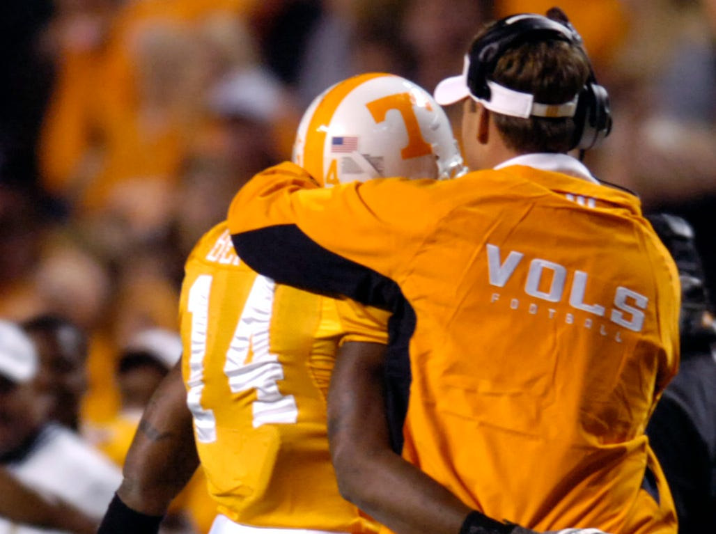 Tennessee cornerback Eric Berry (14) is congratulated by head coach Lane Kiffin after an interception against Memphis on Saturday, Nov. 7, 2009 at Neyland Stadium. Coach Kiffin later said that he mistakenly thought Berry broke the NCAA interception record with that interception, he has one more to go.