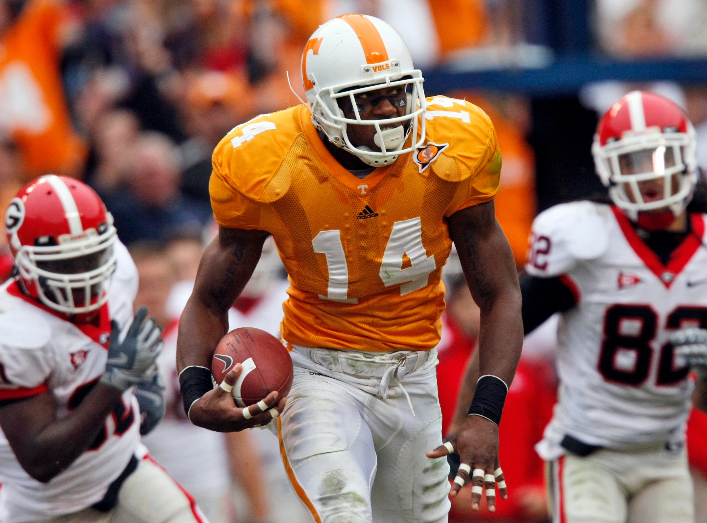 In this Oct. 10, 2009, file photo, Tennessee's Eric Berry (14) returns a fumble as he gets away from Georgia's Michael Moore (82) and Eric Elliot (30) during the second half of an NCAA college football game in Knoxville, Tenn.  Berry is a top prospect in the NFL draft.