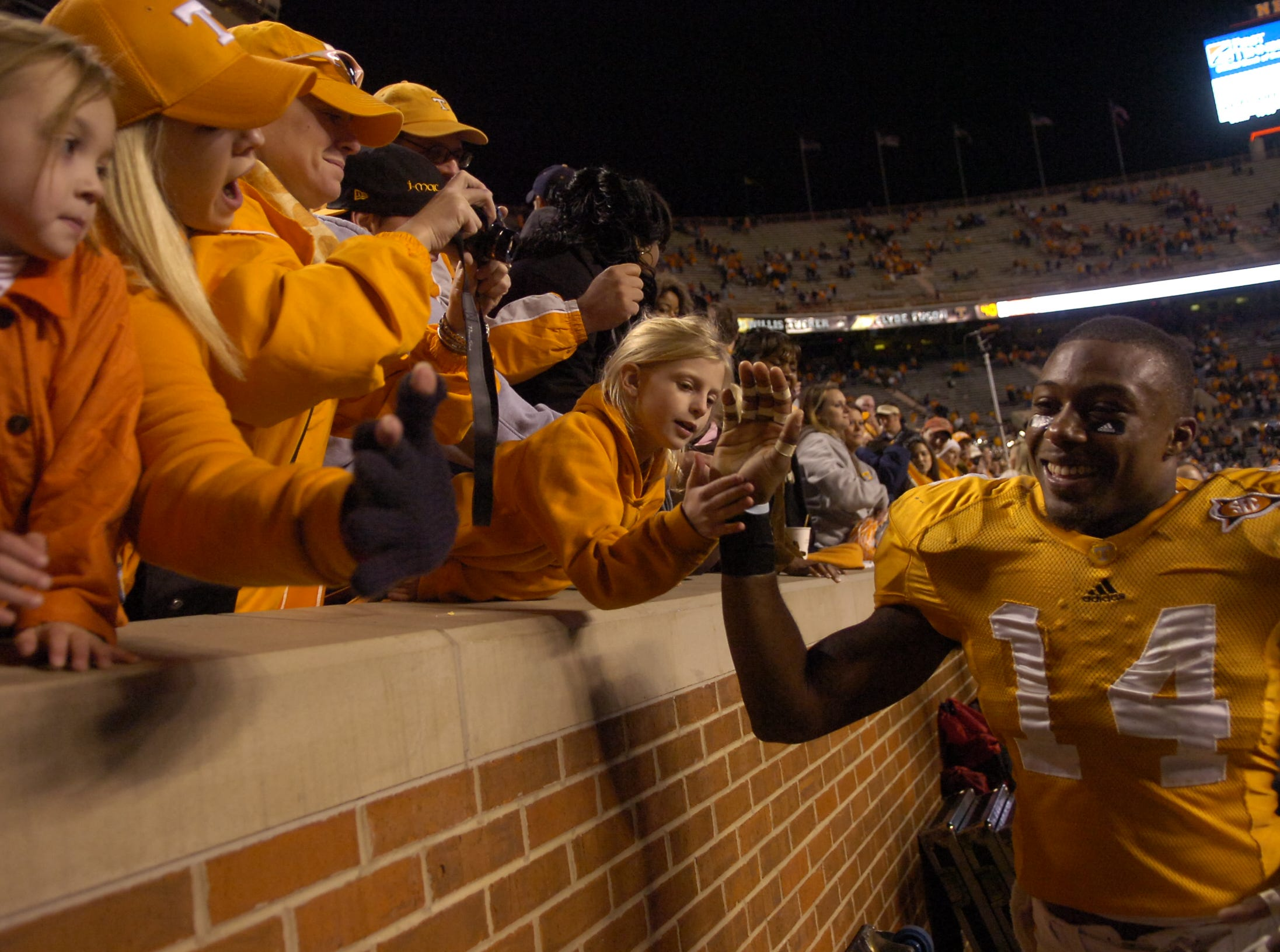 Tennessee cornerback Eric Berry (14) greets fans after the 31-16 win over Vanderbilt on Saturday, Nov. 21, 2009 at Neyland Stadium.