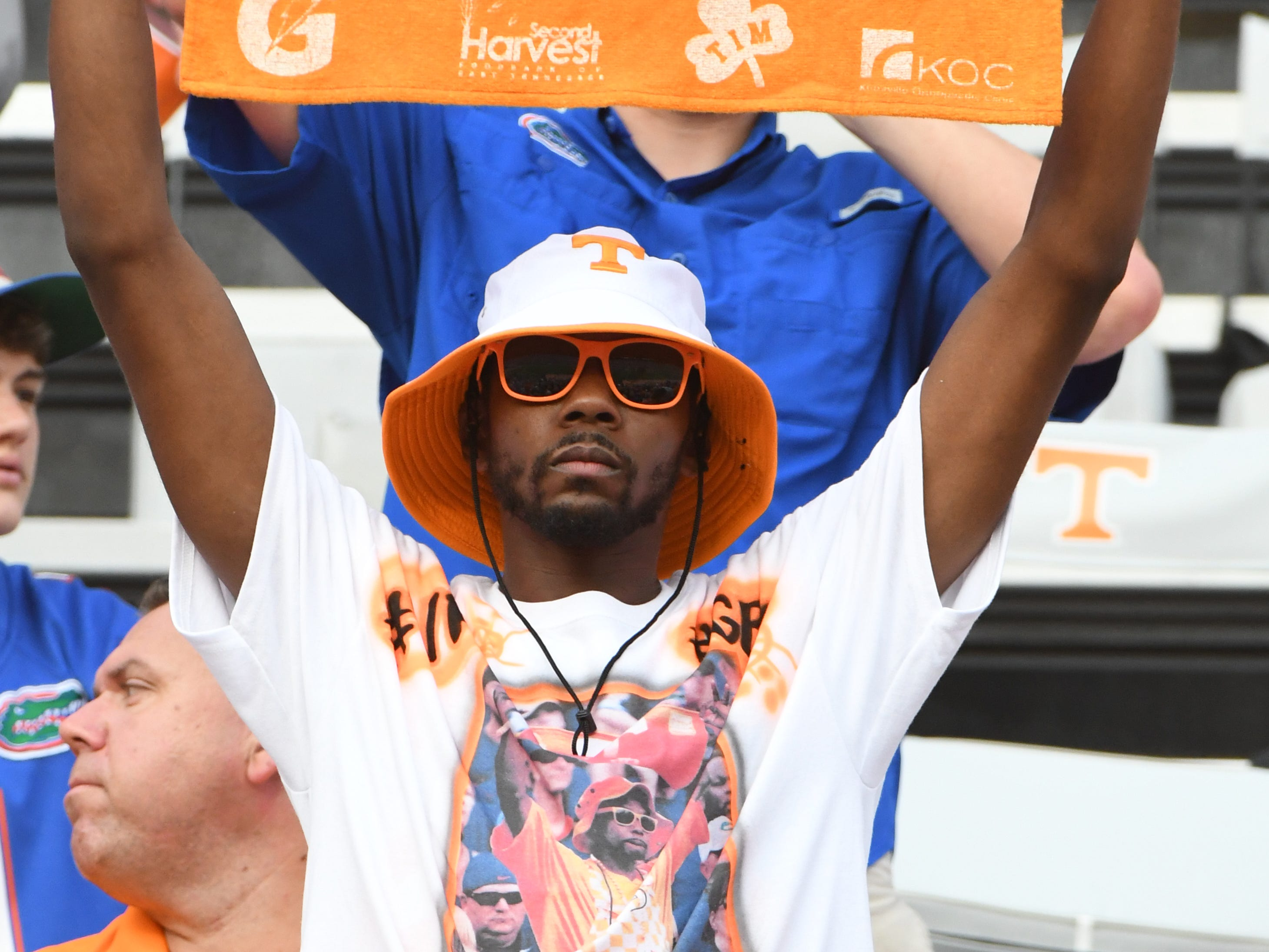 A Tennessee fan cheers from the stands during a game between Tennessee and Florida at Neyland Stadium in Knoxville, Tennessee on Saturday, September 22, 2018.