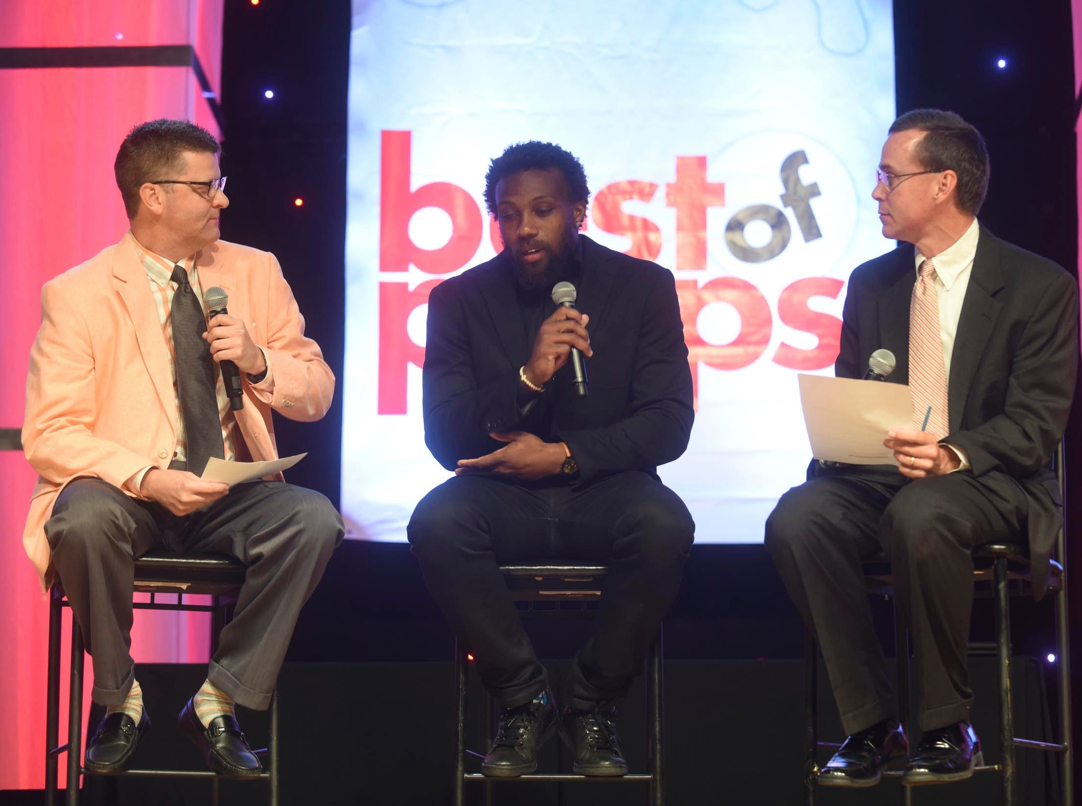 Kansas City Chiefs football player Eric Berry, center, answers questions from Stephen Hargis, left, and David Paschall at the Best of Preps banquet Thursday, June 9, 2016, at the Chattanooga Convention Center.