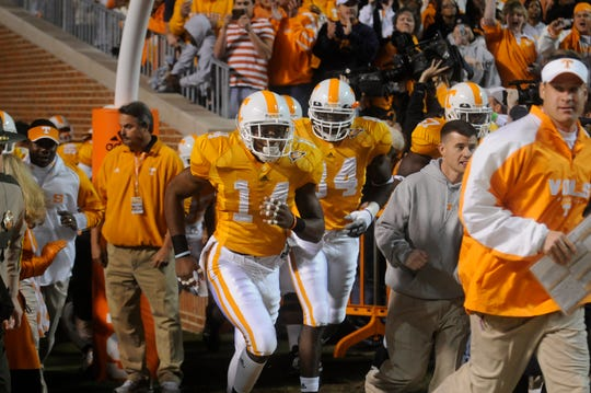 Tennessee's Eric Berry (14) leads the team onto the field after the seniors were introduced prior to the game Nov. 21, 2009.