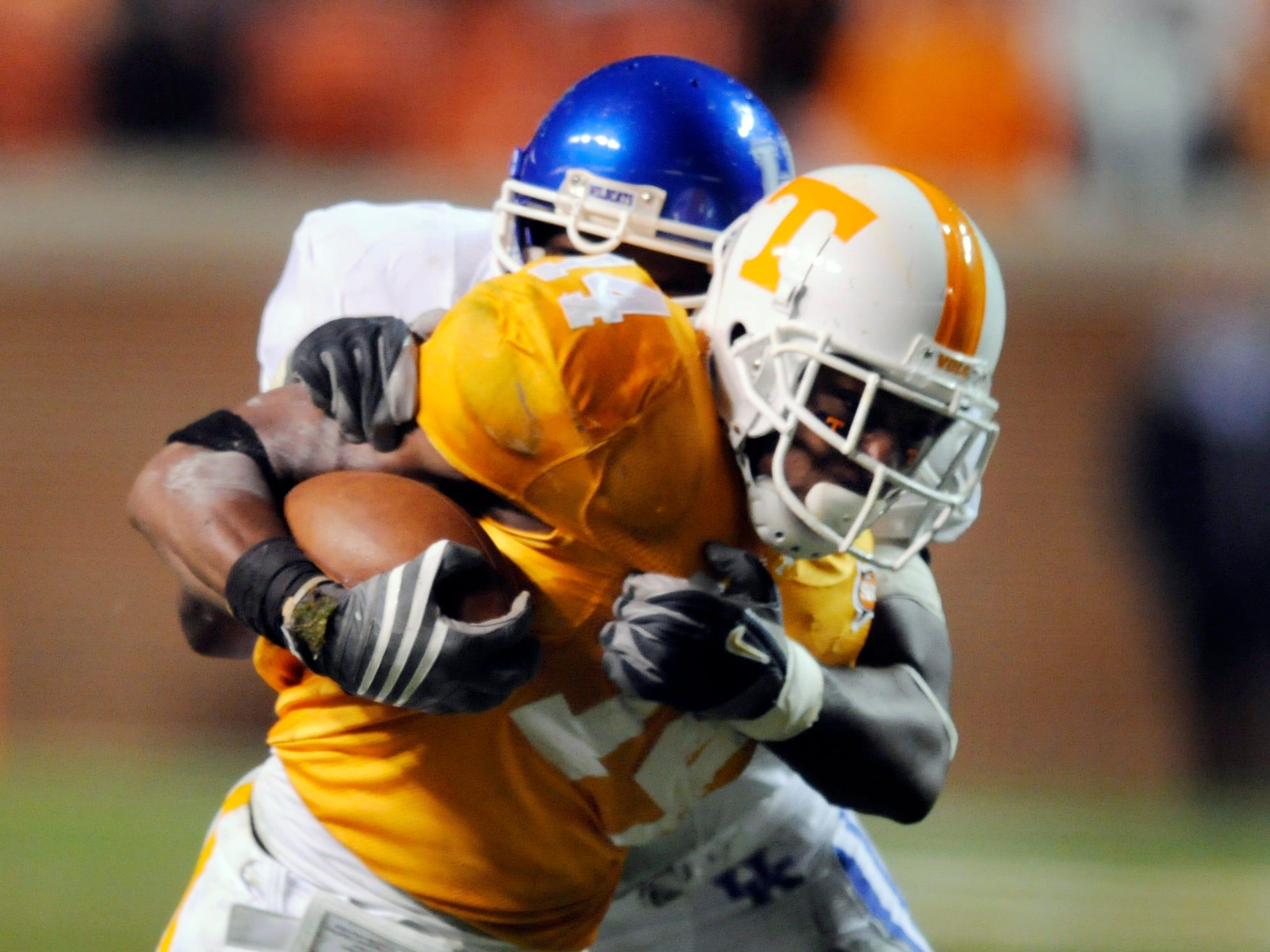 Tennessee's Eric Berry (14) slips away from a Kentucky defender Saturday night in Neyland Stadium.