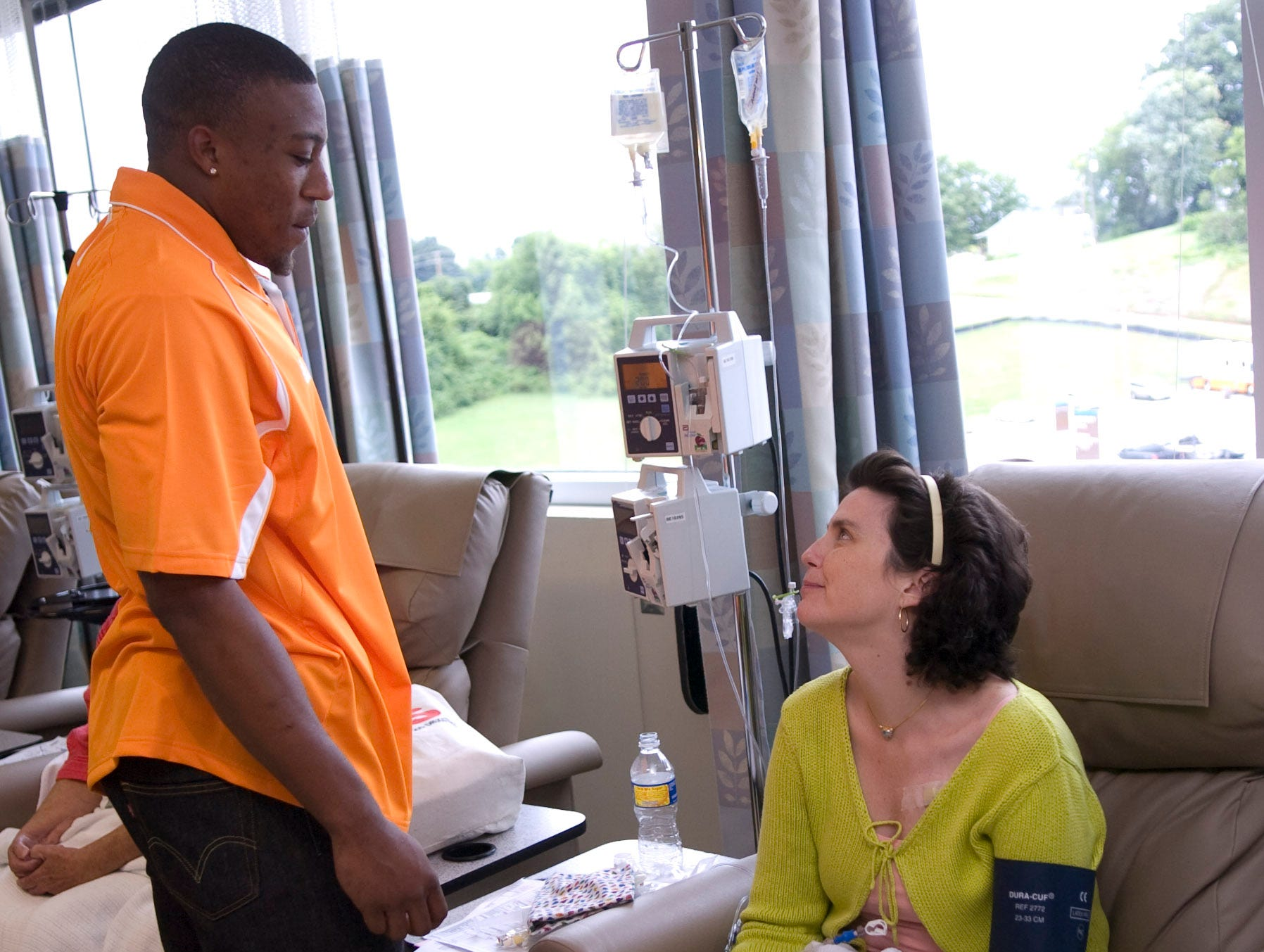 UT football player Eric Berry talks with cancer patient Deborah Rhatigan. Several members of the football team visited patients at the UT Medical Center Cancer Institute on Wednesday.