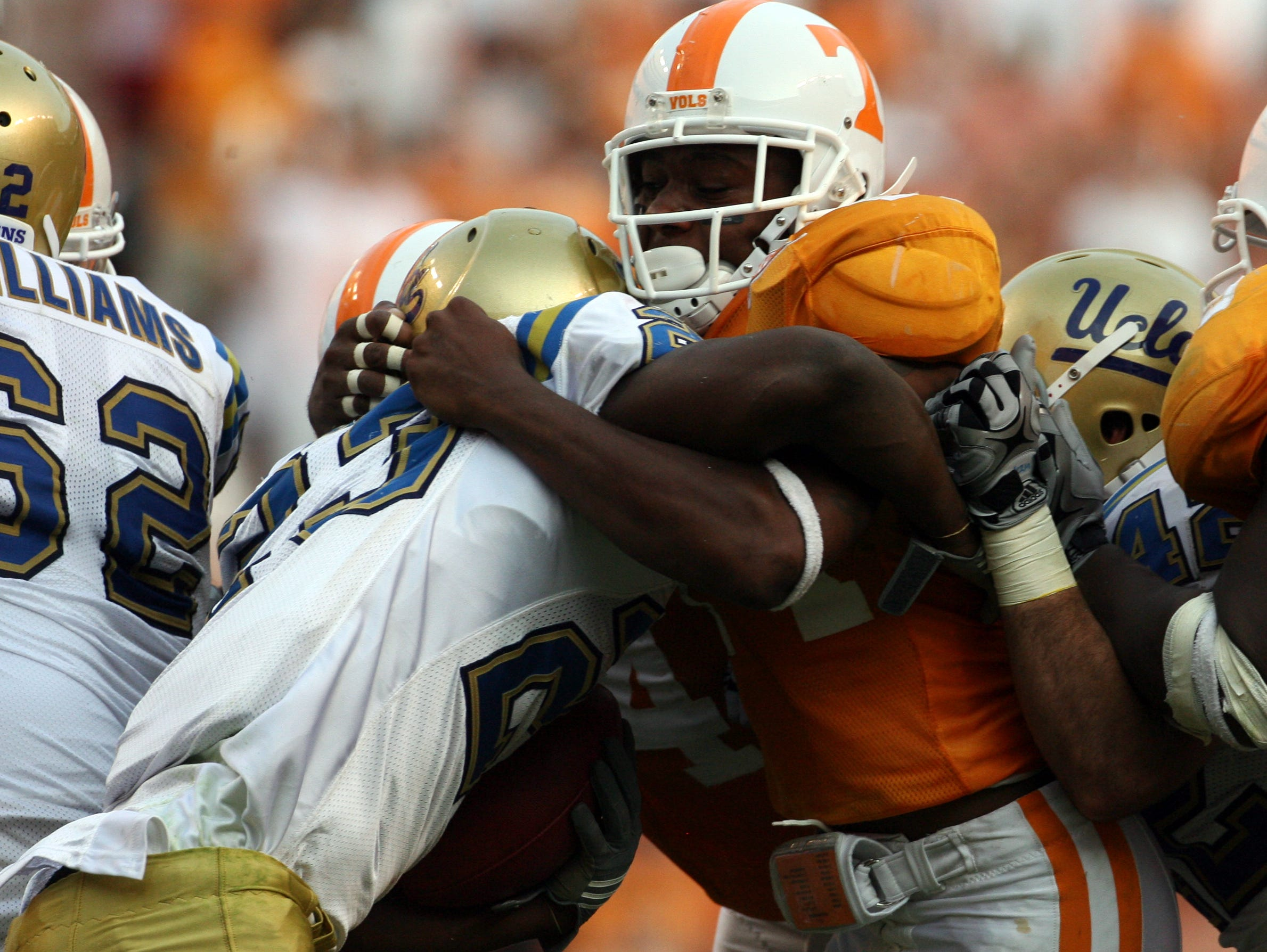 Tennessee cornerback Eric Berry (14) holds on as UCLA tailback Johnathan Franklin (23) moves the ball on Saturday, Sept. 12, 2009 at Neyland Stadium.  The Vols lost 19-15 to the Bruins.