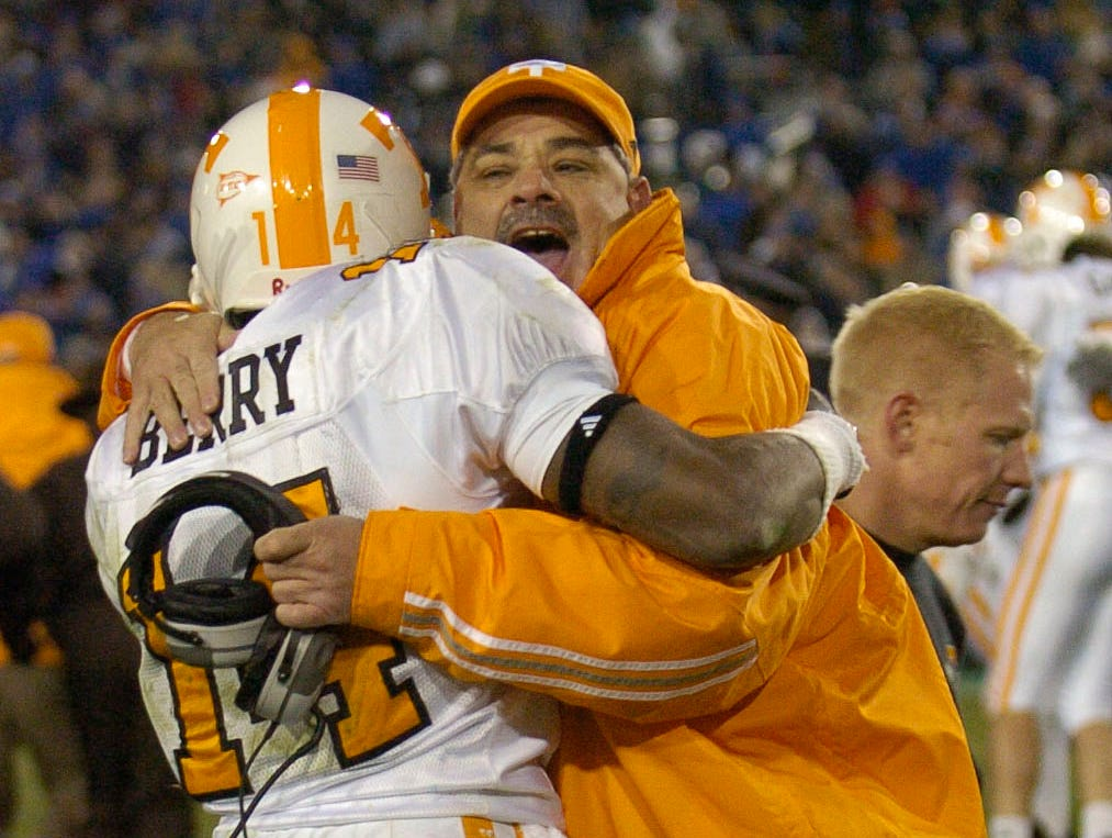 Tennessee defensive coordinator John Chavis celebrates victory with defensive back Eric Berry on Saturday in Lexington, Ky. The Vols (9-3) escaped with a 52-50 victory in 4 overtime periods and play LSU in next Saturday's SEC title game in Atlanta. It was their 23rd straight win over the Wildcats.