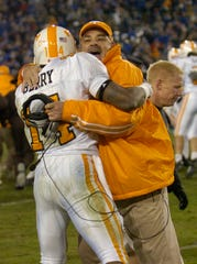 Tennessee defensive coordinator John Chavis and defensive back Eric Berry celebrate a four-overtime victory over Kentucky in 2007. Chavis was with the Vols 20 years, including its national championship season in 1998.