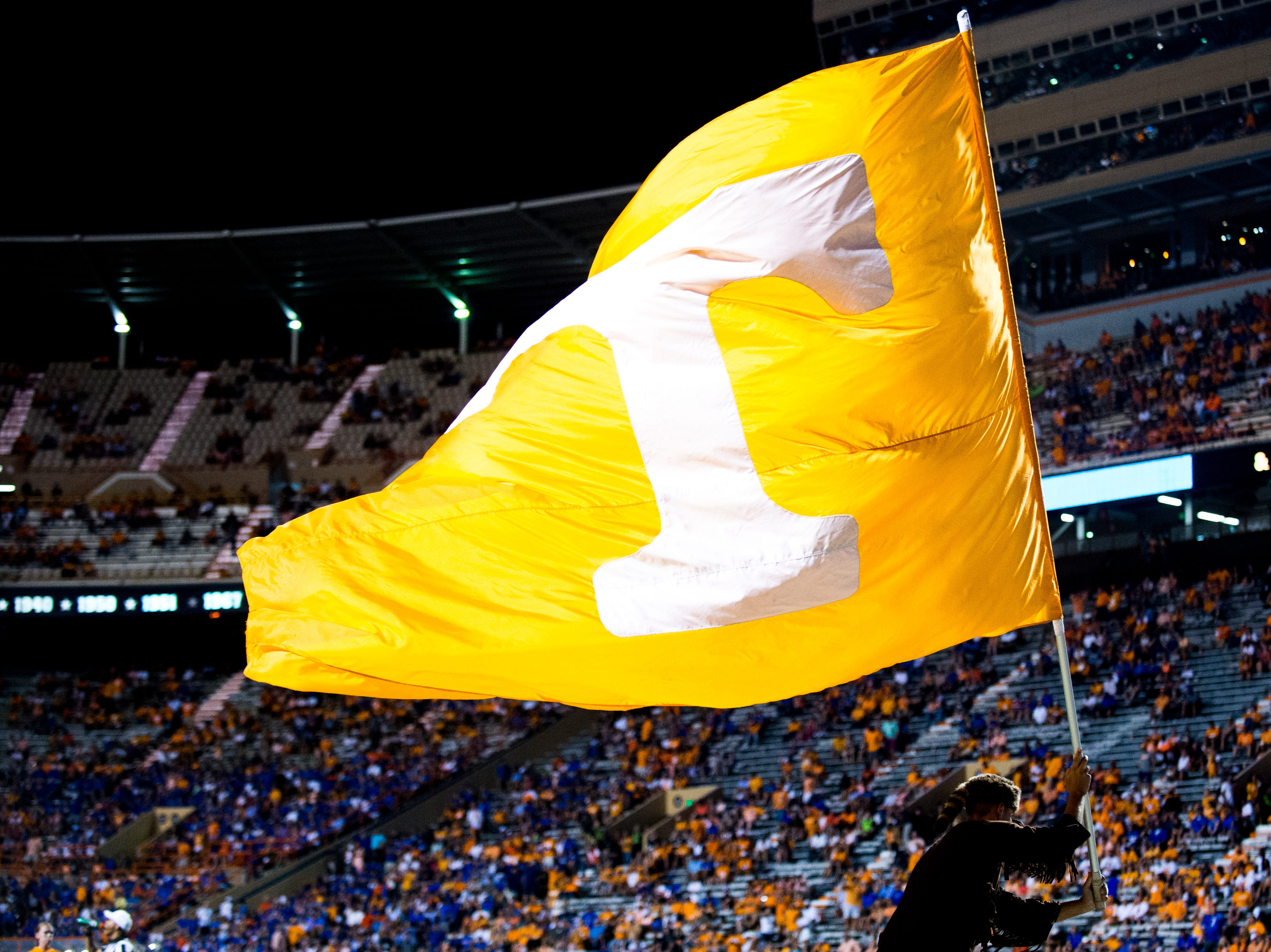 The Volunteer runs off the field with the Tennessee flag during a game between Tennessee and Florida at Neyland Stadium in Knoxville, Tennessee on Saturday, September 22, 2018.
