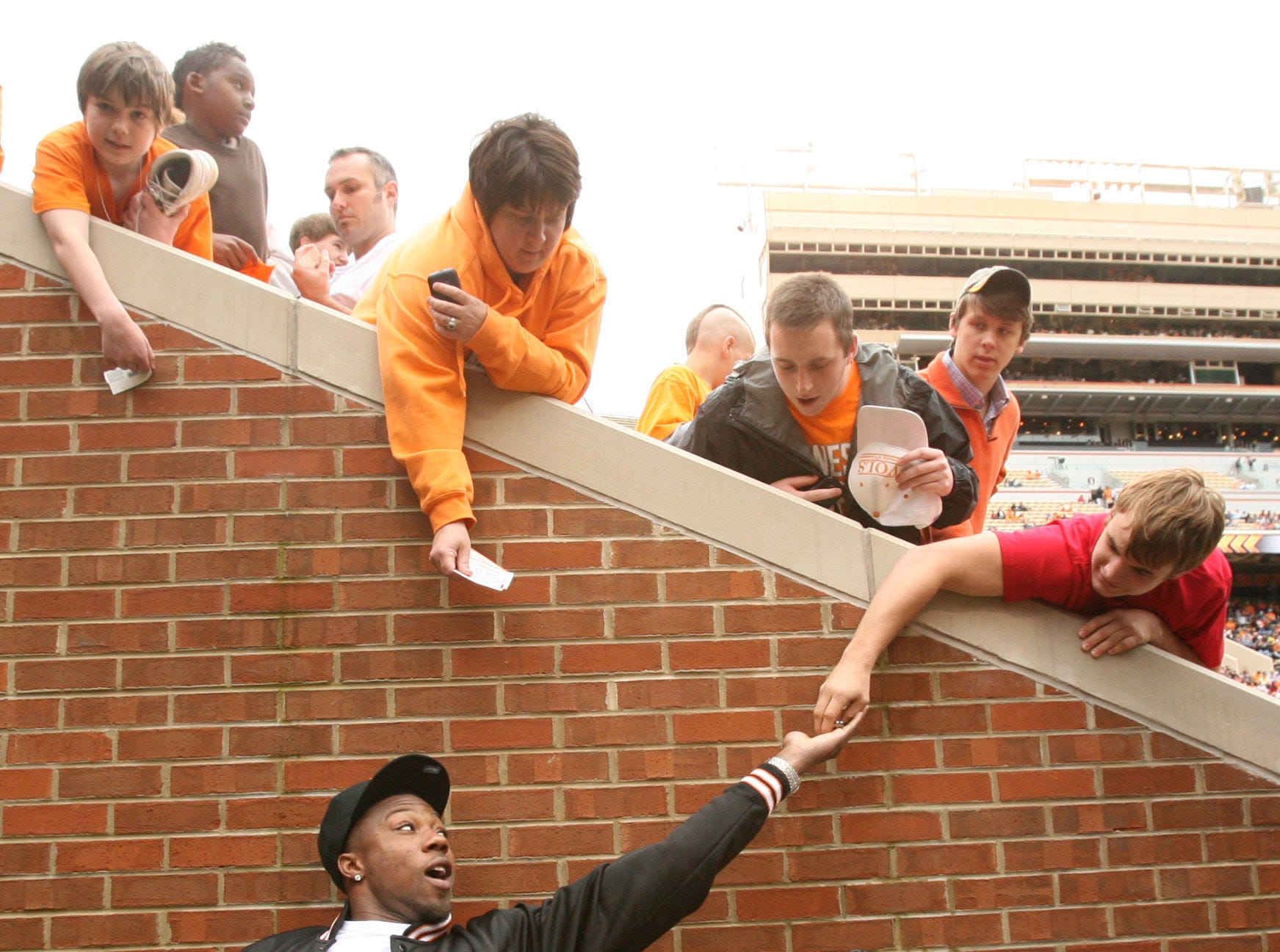 Former Tennessee football player Eric Berry signs autographs for fans during the Orange and White game at Neyland Stadium Saturday, April 16, 2011.  White won the game 24-7 over Orange.