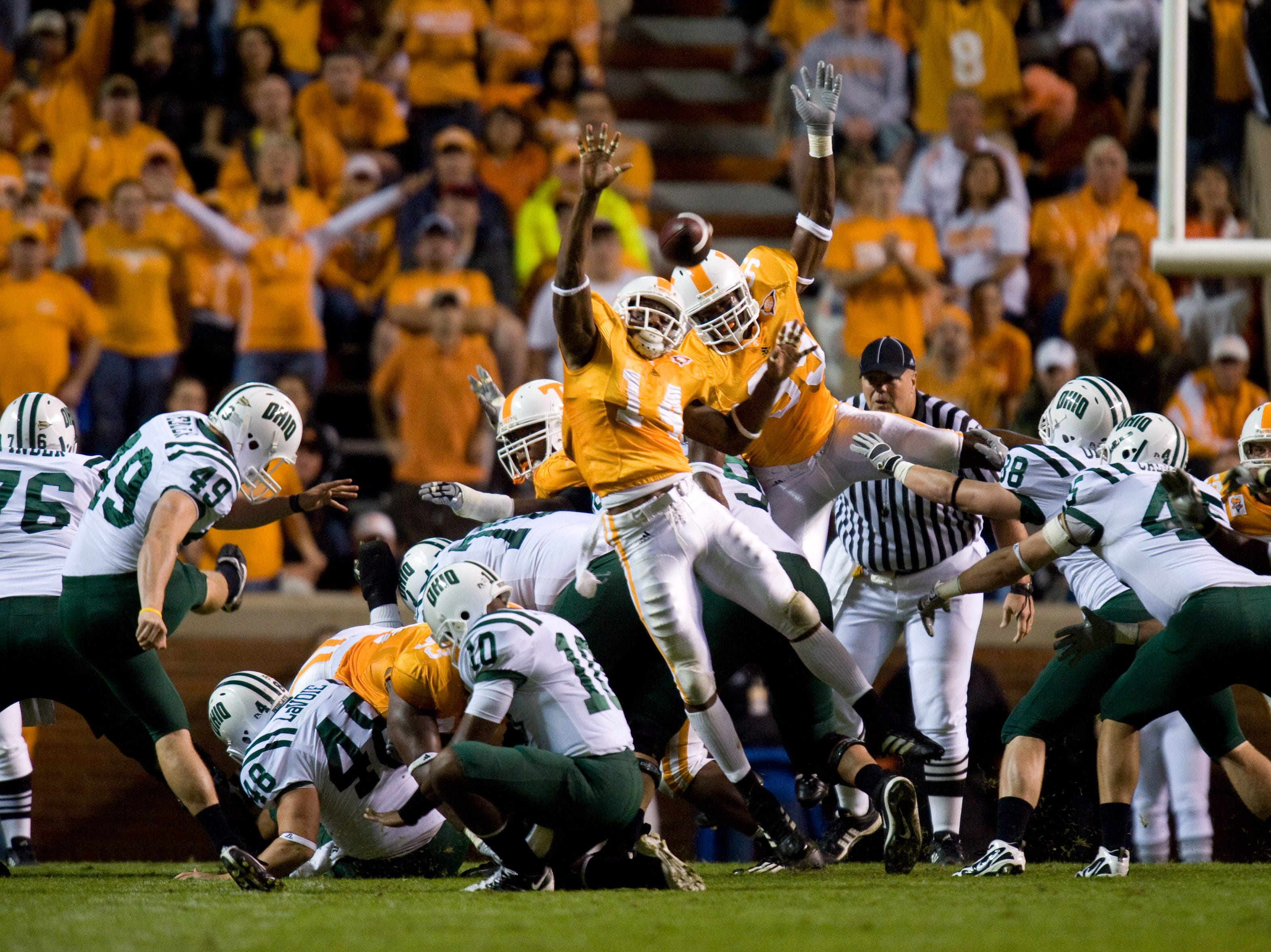 Tennessee special teams players Eric Berry (14) and Ben Martin try to block a field goal attempt by Ohio place kicker Matt Weller on Saturday, Sept. 26, 2009 at Neyland Stadium. The Vols evened their record to 2-2 with a 34-23 win.