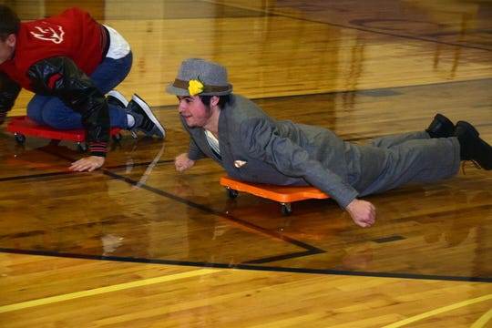 Tyler Skinner, 17, finishes the last leg of an obstacle course pushing his cart hard toward the finish line.