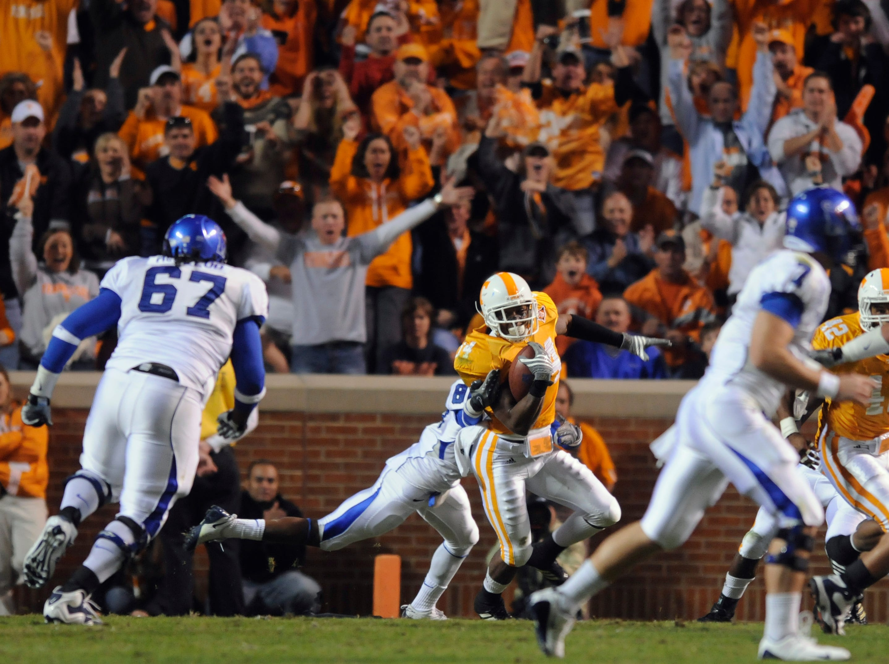 Tennessee cornerback Eric Berry (14) catches in interception from Memphis defensive back Alton Starr (7) during action Saturday, Nov 7, 2009 in Neyland Stadium in Knoxville.