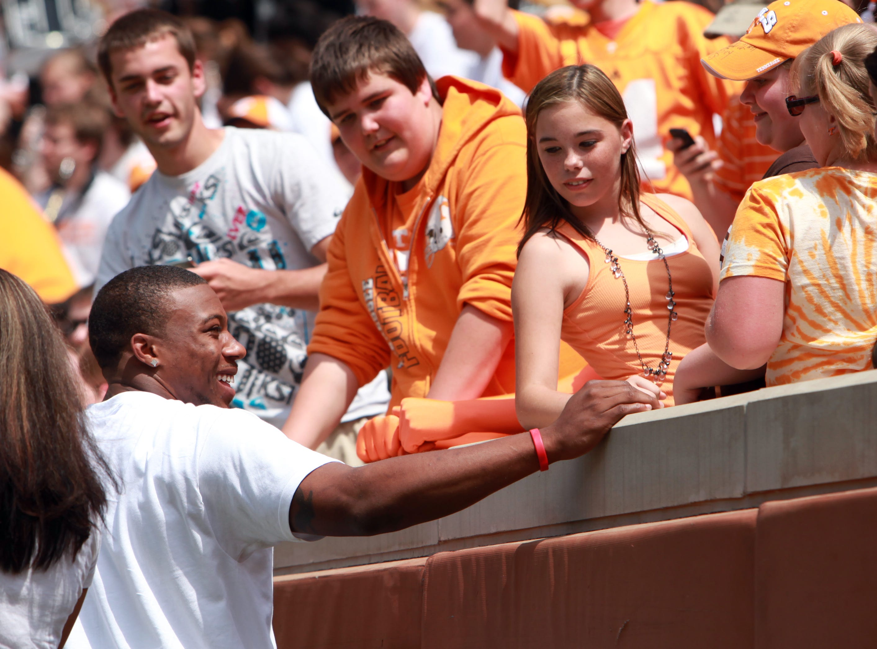 Former Tennessee standout Eric Berry, left, greets fans during the Orange and White game at Neyland Stadium Saturday, Apr. 17, 2010.