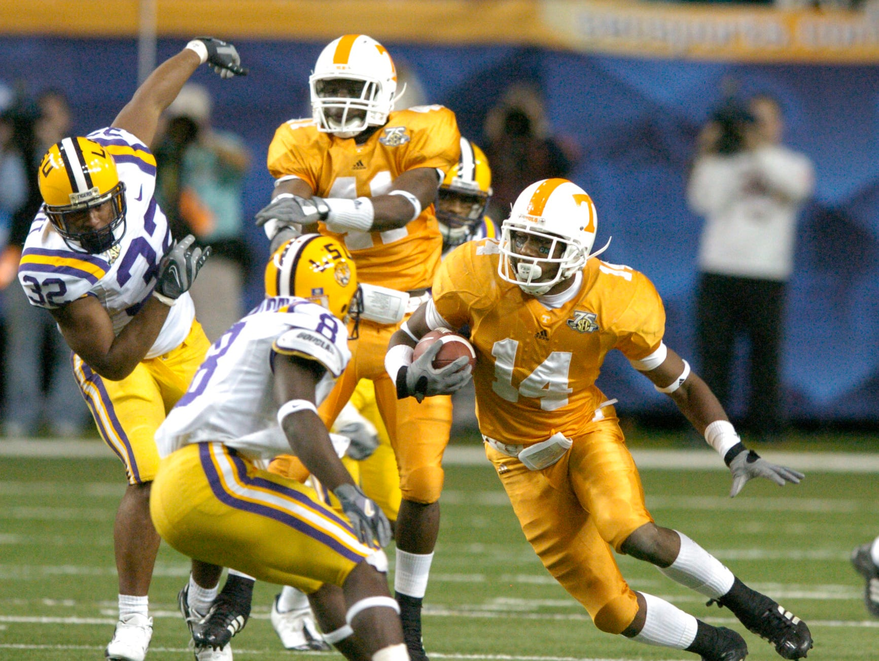 Tennessee safety Eric Berry runs back an LSU fumble during the SEC championship game on Saturday in Atlanta. The Tigers won 21-14, sending the Vols (9-4) to the Outback Bowl in Tampa for the second year in a row.