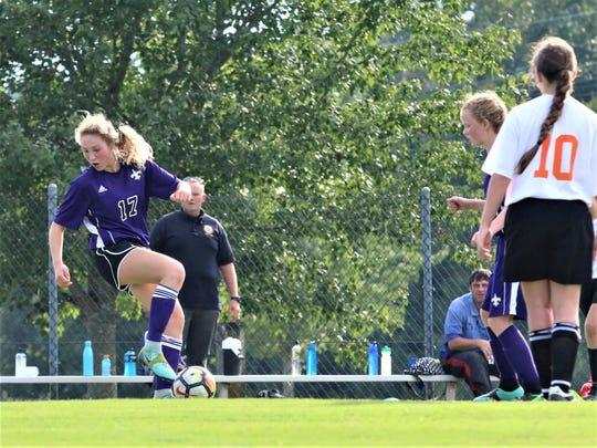 Eighth-grader McKenzie Burkhalter shows some fancy footwork on the field.