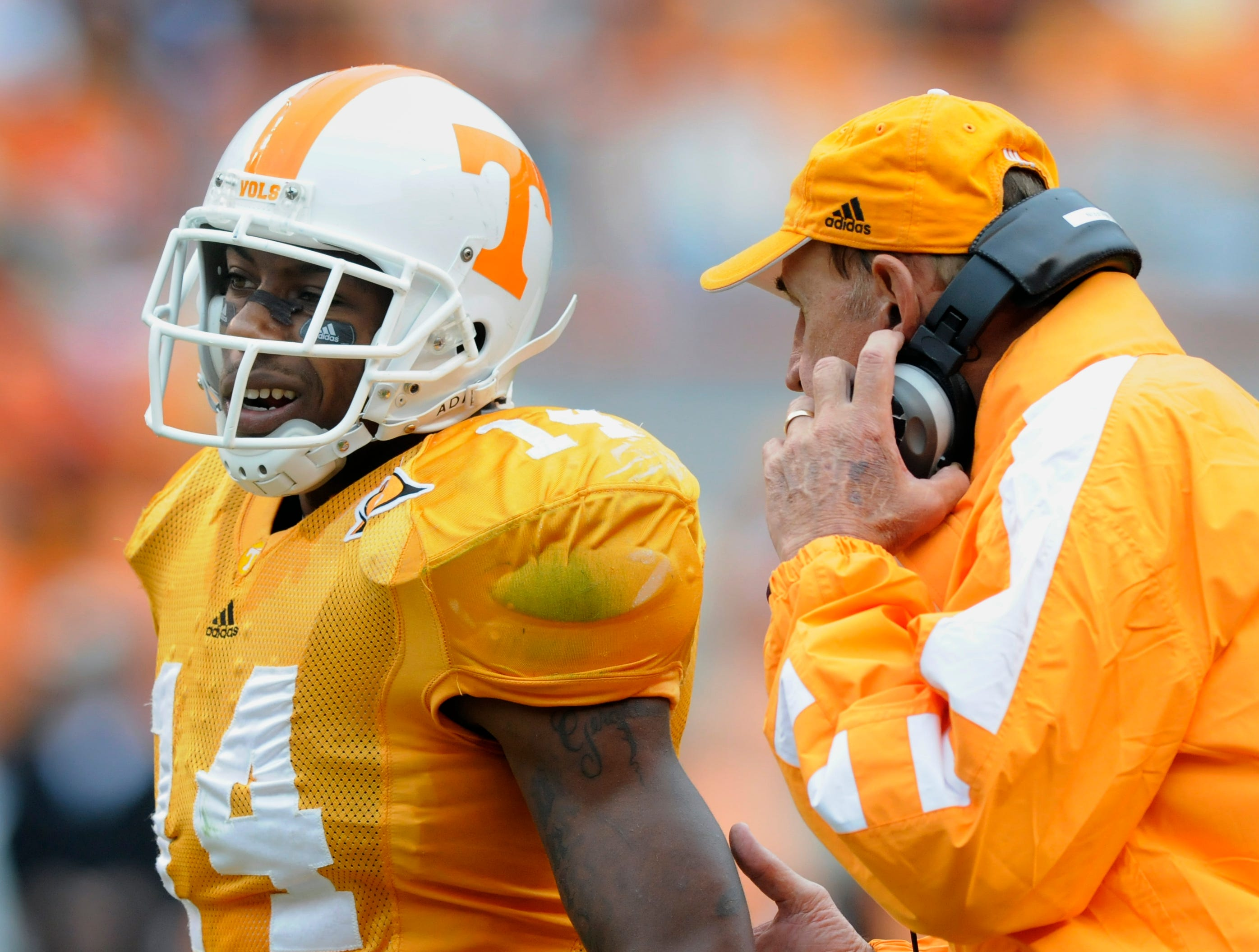 Tennessee defensive coordinator Monte Kiffin talks to cornerback Eric Berry (14) during a timeout in their victory against Georgia on Saturday, Oct. 10, 2009 at Neyland Stadium.