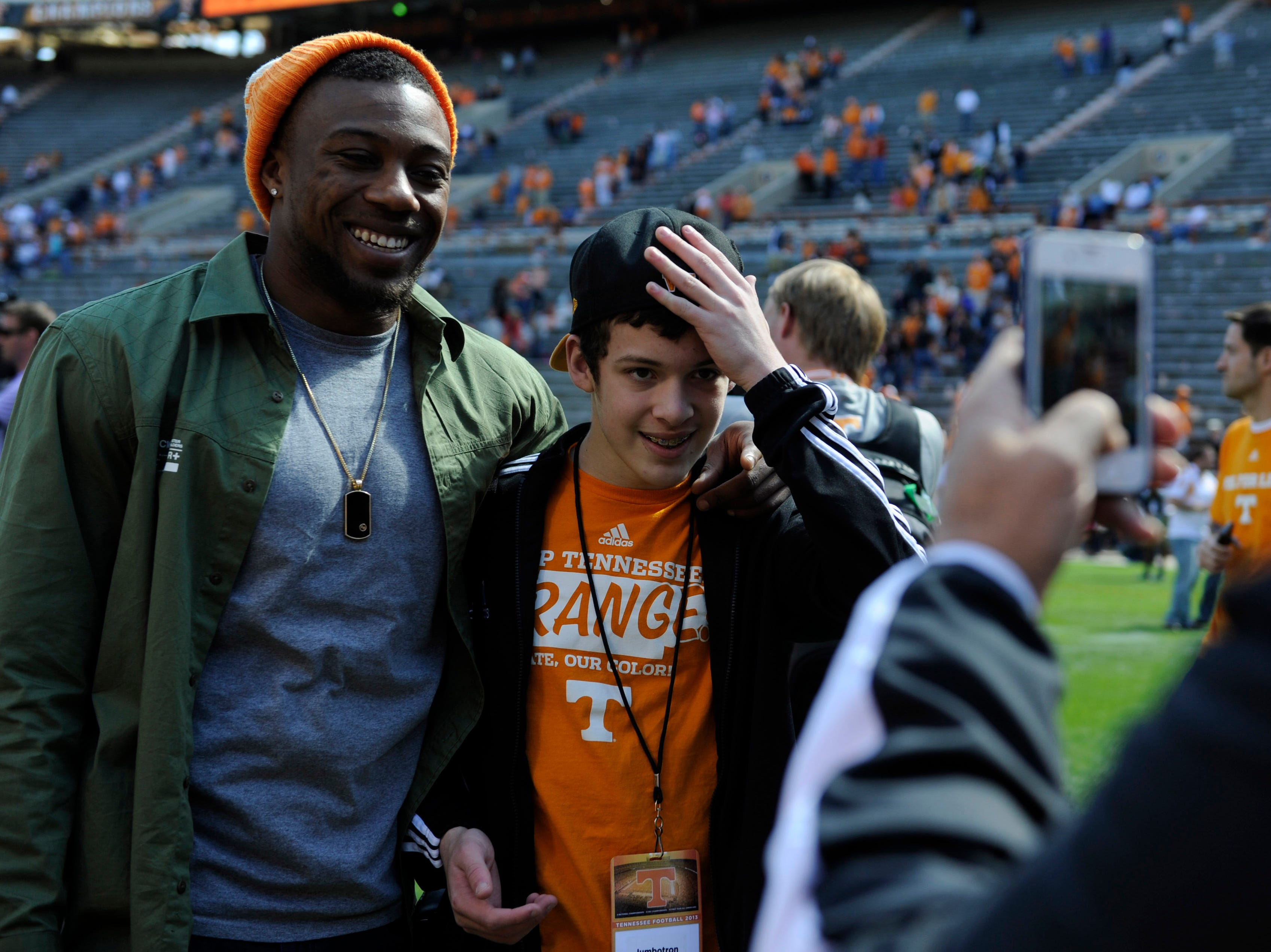 Former Volunteer Eric Berry, left, takes a photo with a fan after the Orange and White game at Neyland Stadium on Saturday, April 20, 2013.