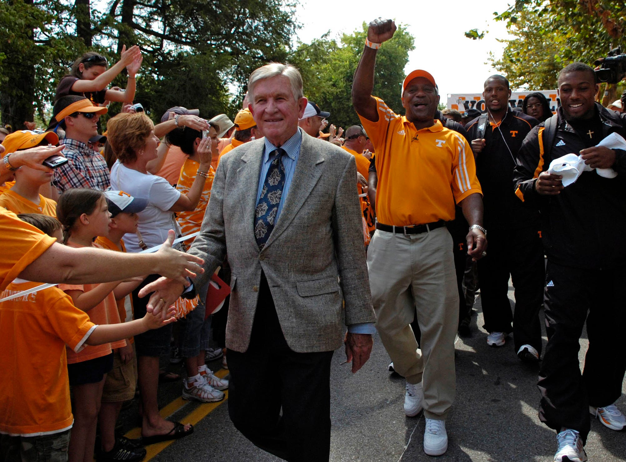 Former UT head coach Johnny Majors, former running back James Berry and his son Eric Berry participate in the Vol Walk before UT played UCLA on Saturday, September 12, 2009 at Neyland Stadium.