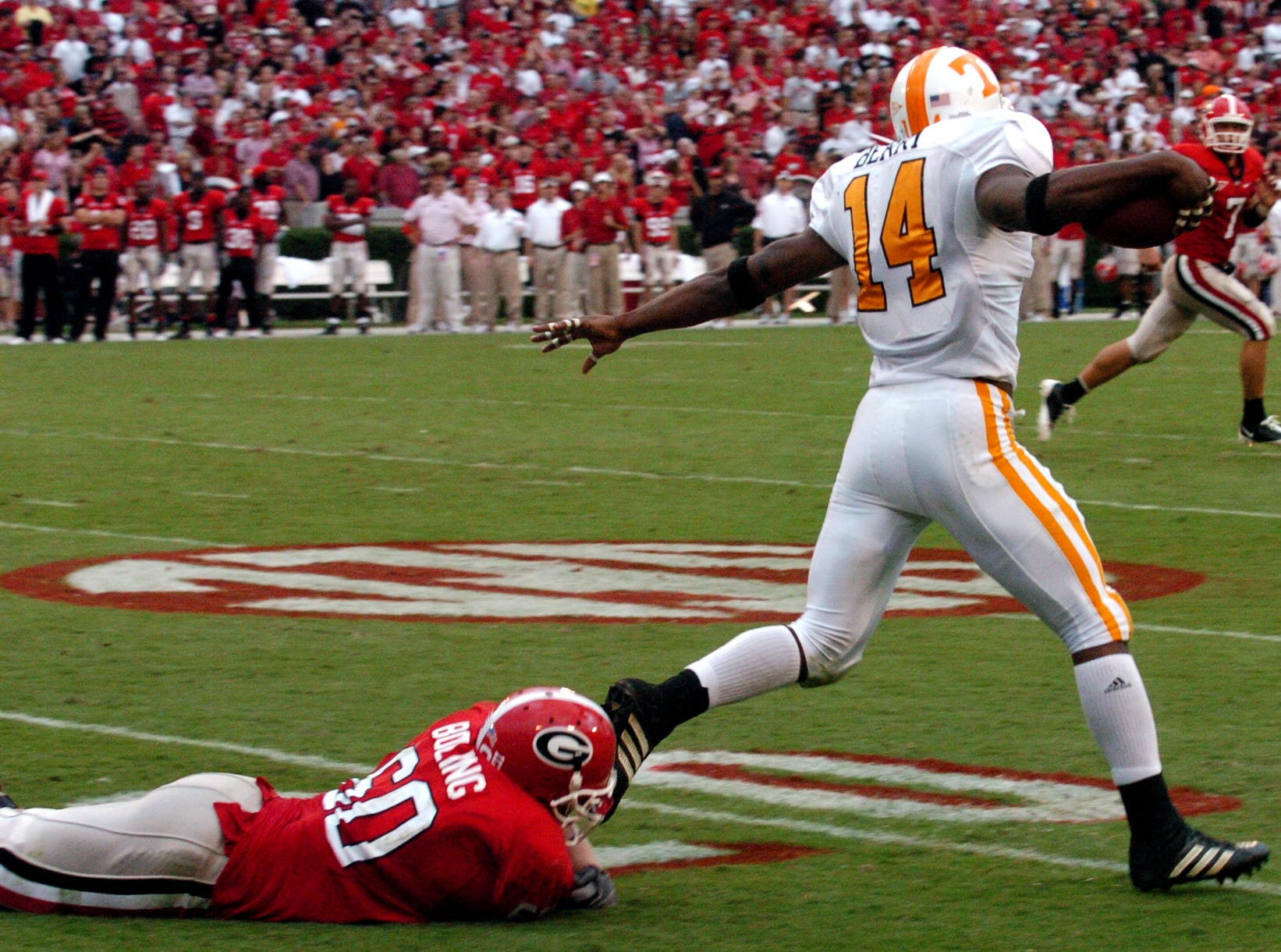 MICHAEL PATRICK/KNOXVILLE NEWS SENTINEL - Saturday, October 11, 2008  Tennessee safety Eric Berry escapes a tackle by Georgia guard Clint Boling while running back an interception on Saturday at Sanford Stadium in Athens, Ga. The 54-yard return in the third quarter to set up Tennessee's second touchdown. Georgia beat Tennessee 26-14.