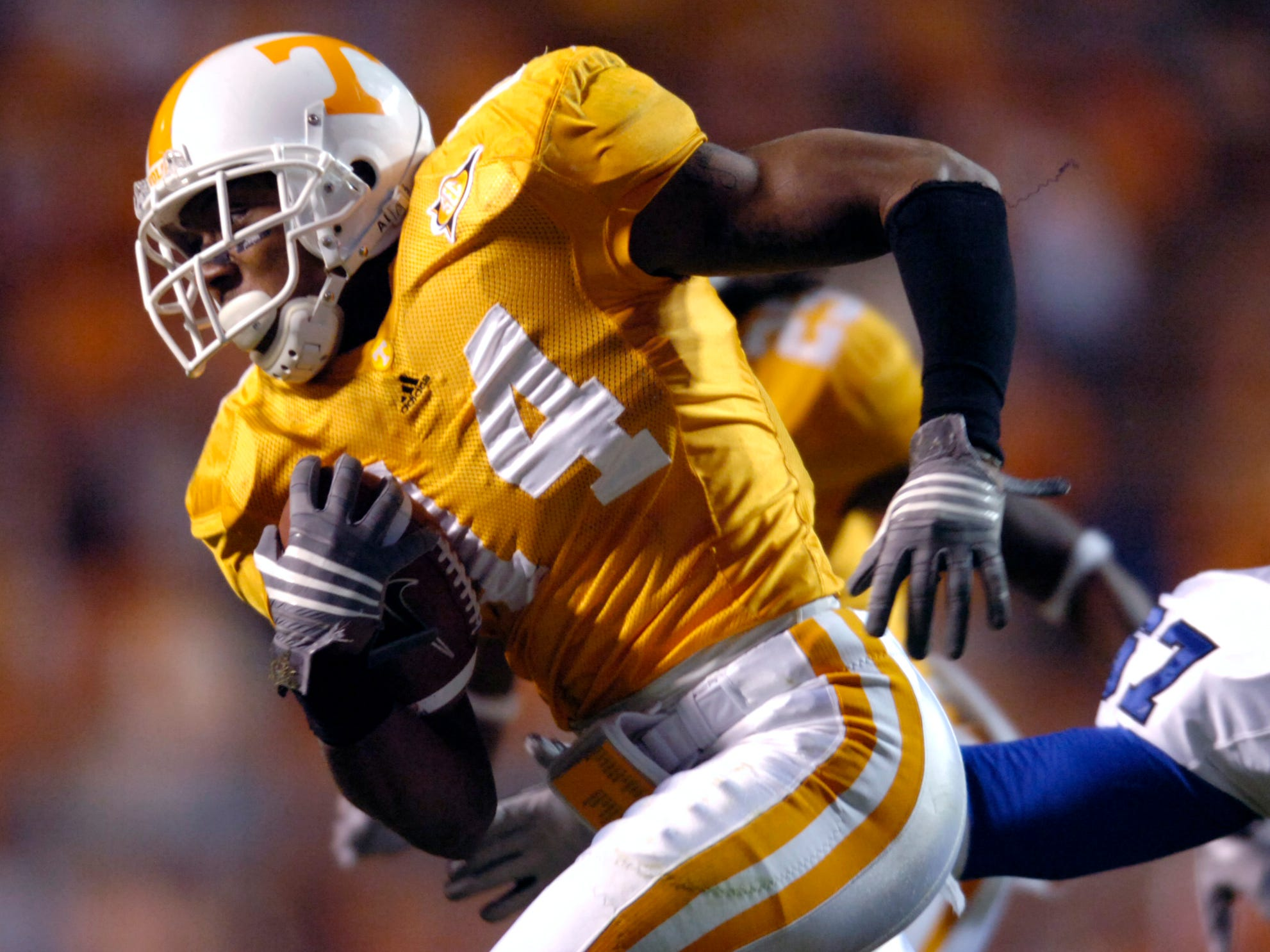 Tennessee cornerback Eric Berry (14) intercepts a pass from Memphis  quarterback Will Hudgens (7) and is one interception and 8 yards away from breaking an NCAA record on Saturday, Nov. 7, 2009 at Neyland Stadium.