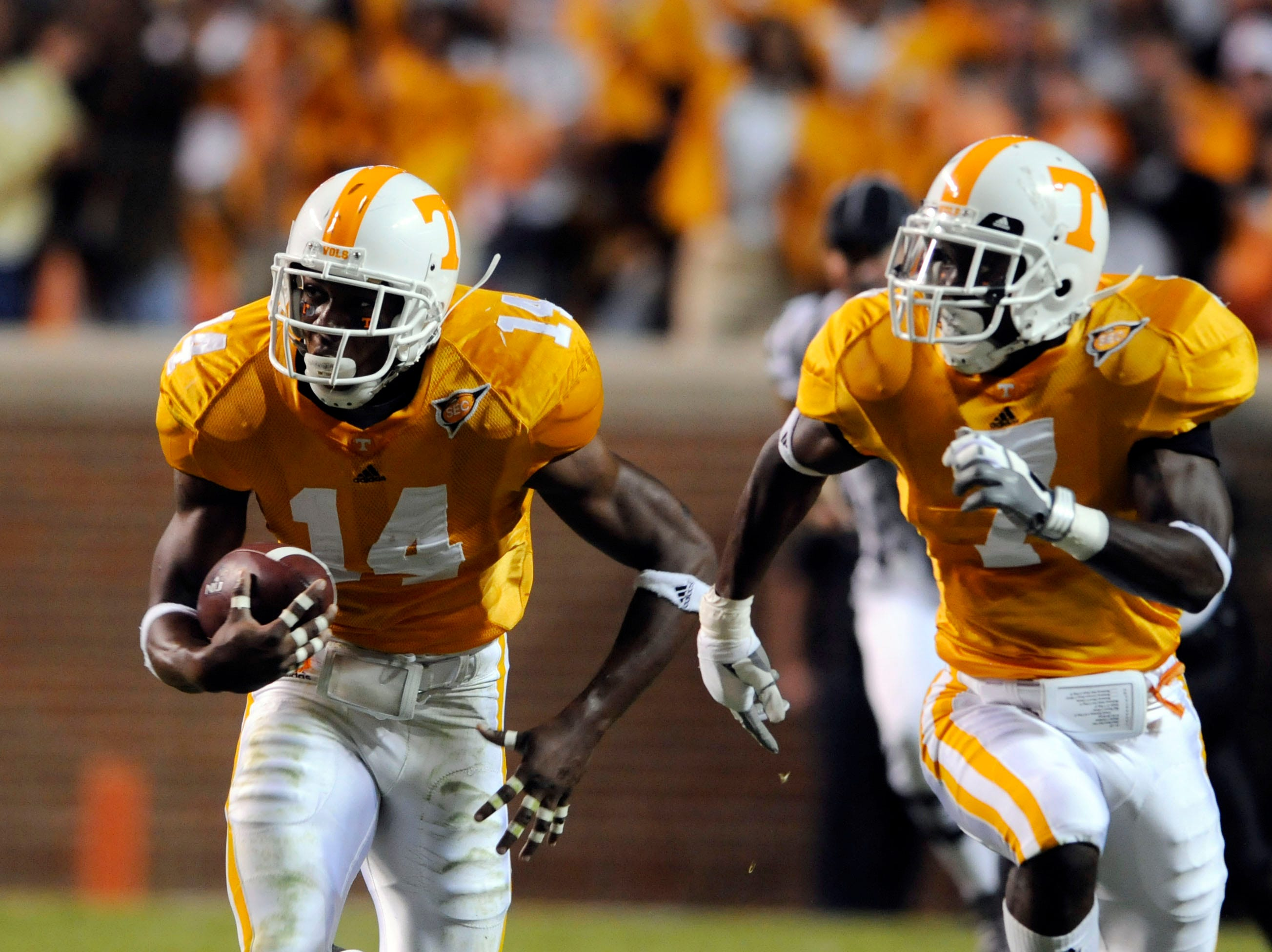 Tennessee defensive back Eric Berry (14) returns an intercepted pass for 48 yards with defensive back Demetrice Morley (7) Saturday in Neyland Stadium in Knoxville on Saturday, October 4, 2008.