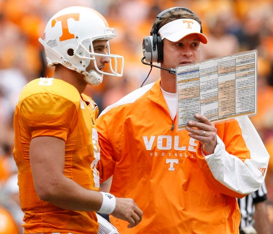 Tennessee coach Lane Kiffin, right, talks to quarterback Jonathan Crompton (8) during the first half of a NCAA college football game against Georgia, Saturday, Oct. 10, 2009 in Knoxville, Tenn. Tennessee won 45-19. (AP Photo/Wade Payne)