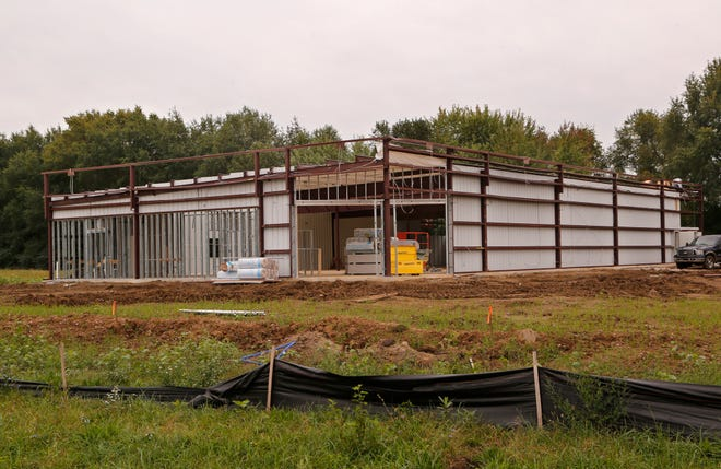 A new Dollar General store under construction Thursday, September 27, 2018, off Ind. 38 in Dayton.