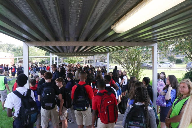 Students attend the first day of school at a Lafayette Parish middle school in 2017.