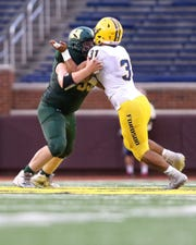 Mason Nelson (left) is a standout on Howell's offensive and defensive lines.