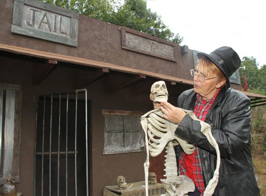 Cindy Murphy-Broadbent prepares the entrance to the Terrorfied Forest and Manor, in 2013.