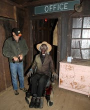 Dean Broadbent indulges his love of spooky remote-controlled monsters at the Terrorfied Forest and Manor near Pinckney, in 2014.