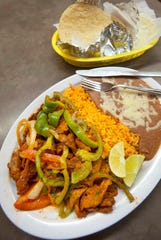 The La Rosita Sol Mexican Taqueria's bistec a la Mexicana is made with beef in a red sauce, mixed with onion and tomatoes and served with Mexican rice, refried beans and corn tortillas.September 27, 2018