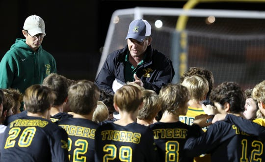 St. X Head Coach Andy Schulten instructs his team against Trinity during their soccer game at St. X High School.Sep. 26, 2018