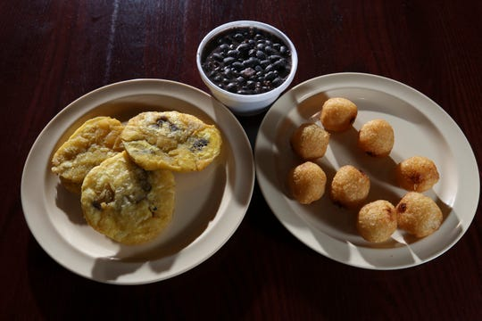 (L-R)  the Tostones, Black Beans and Yuca Bites are side dishes served at Carali's Rotisserie Chicken.