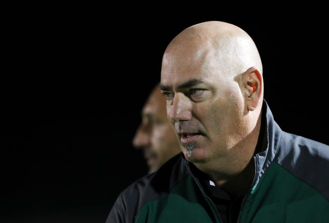 Trinity Head Coach Dale Helfrich watched action against St. X during their soccer game at St. X High School.Sep. 26, 2018