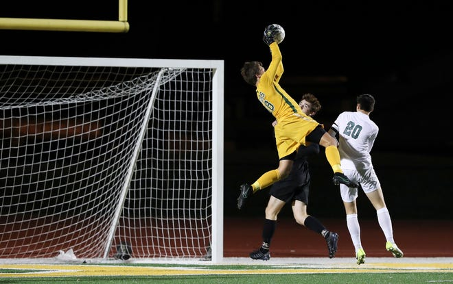 St. X goalie Dolan Dugan blocked an attempt by Trinity at St. X High School.Sep. 26, 2018