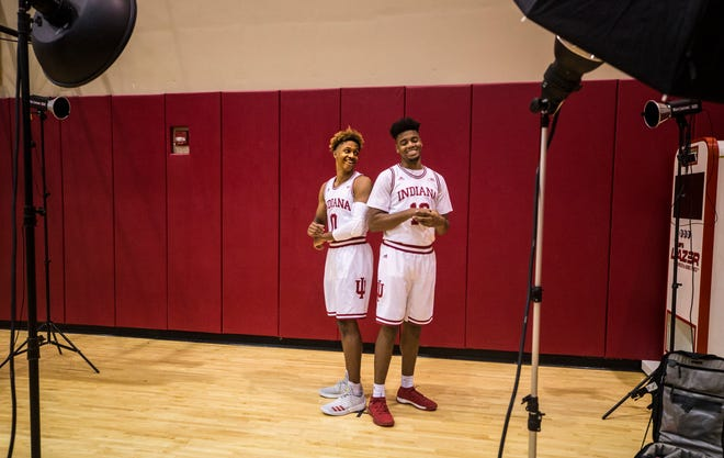 Freshman Romeo Langford, left, and senior Juwan Morgan smile while having their photo taken at IU's media day.