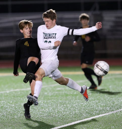 St. X's Wyatt Goodin (4) collided with Trinity's Jack Malcolm (29) during their soccer game at St. X High School.Sep. 26, 2018