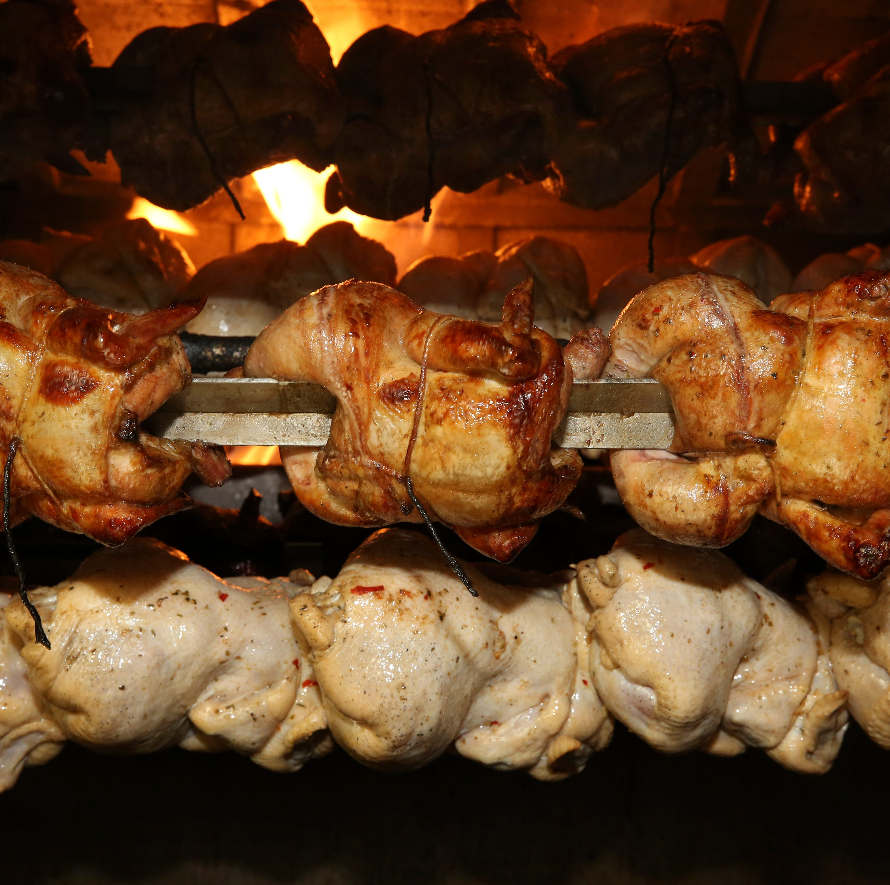 Chicken cooking in the rotisserie at Carali's...